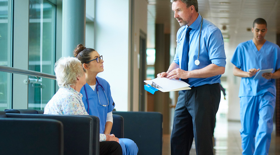 Doctor-talking-to-a-patient-in-hospital-corridor