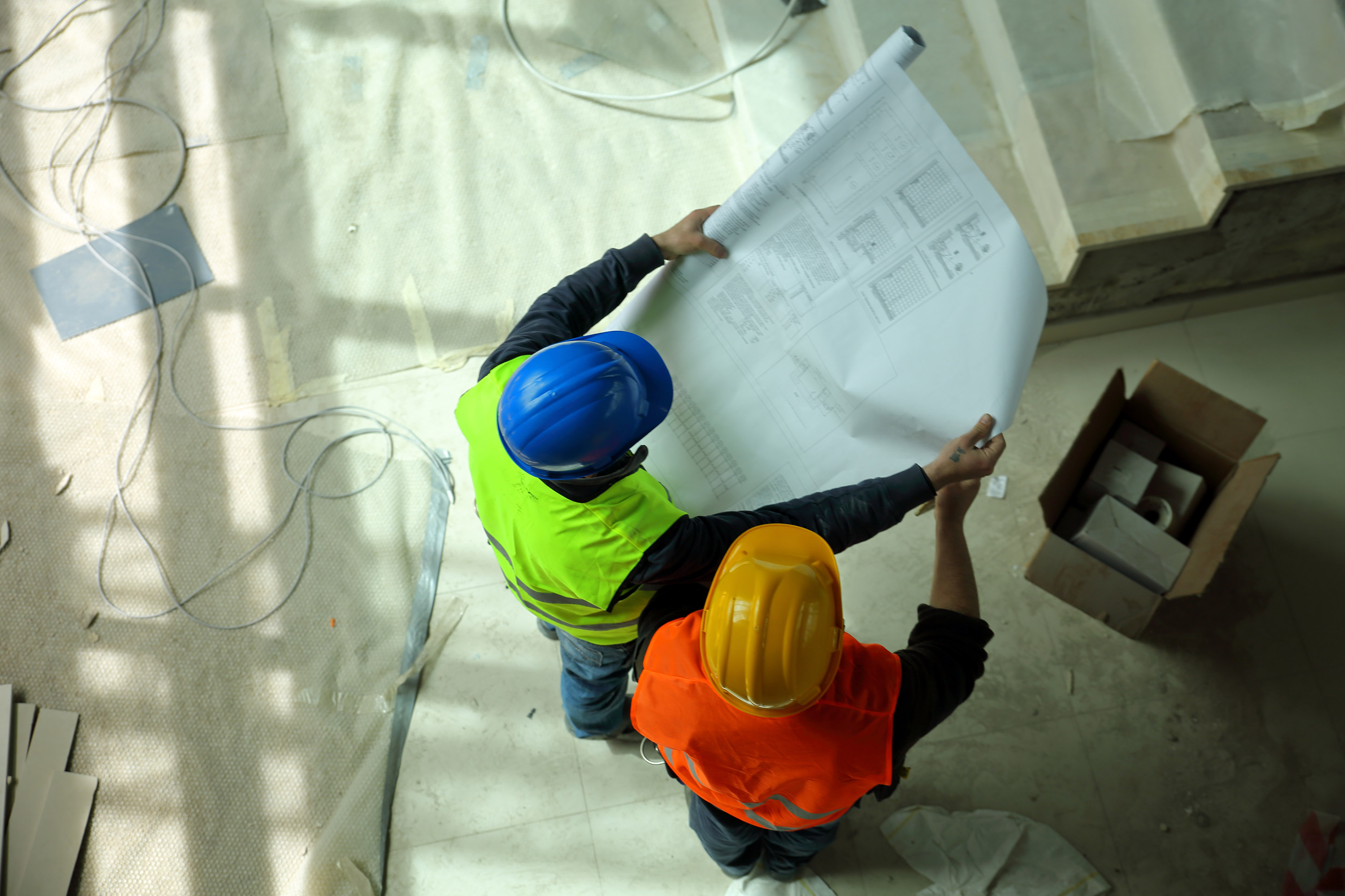 Construction-workers-reading-blueprints