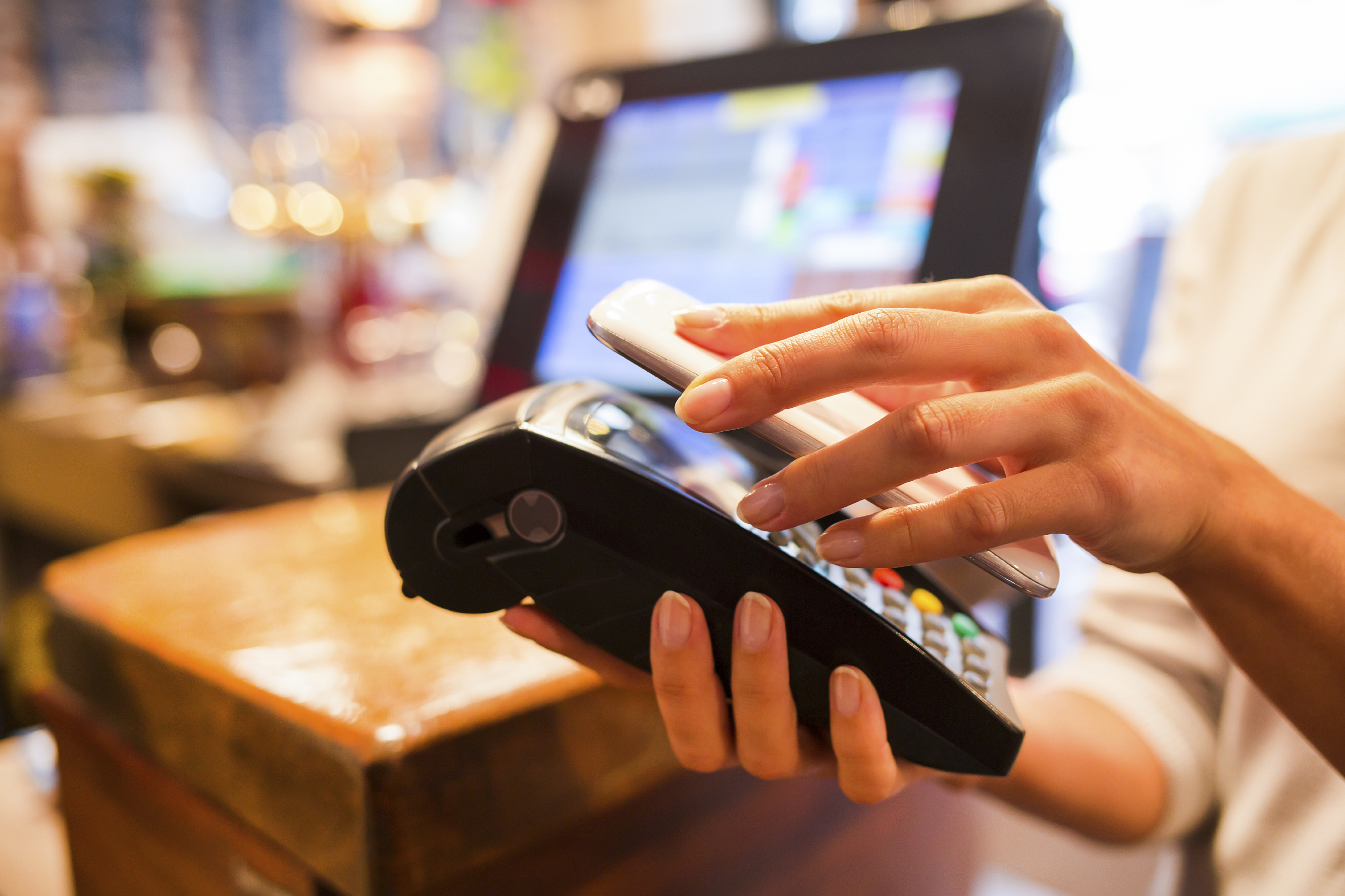 Paying_with_NFC_Tech_on_Mobile_Phone