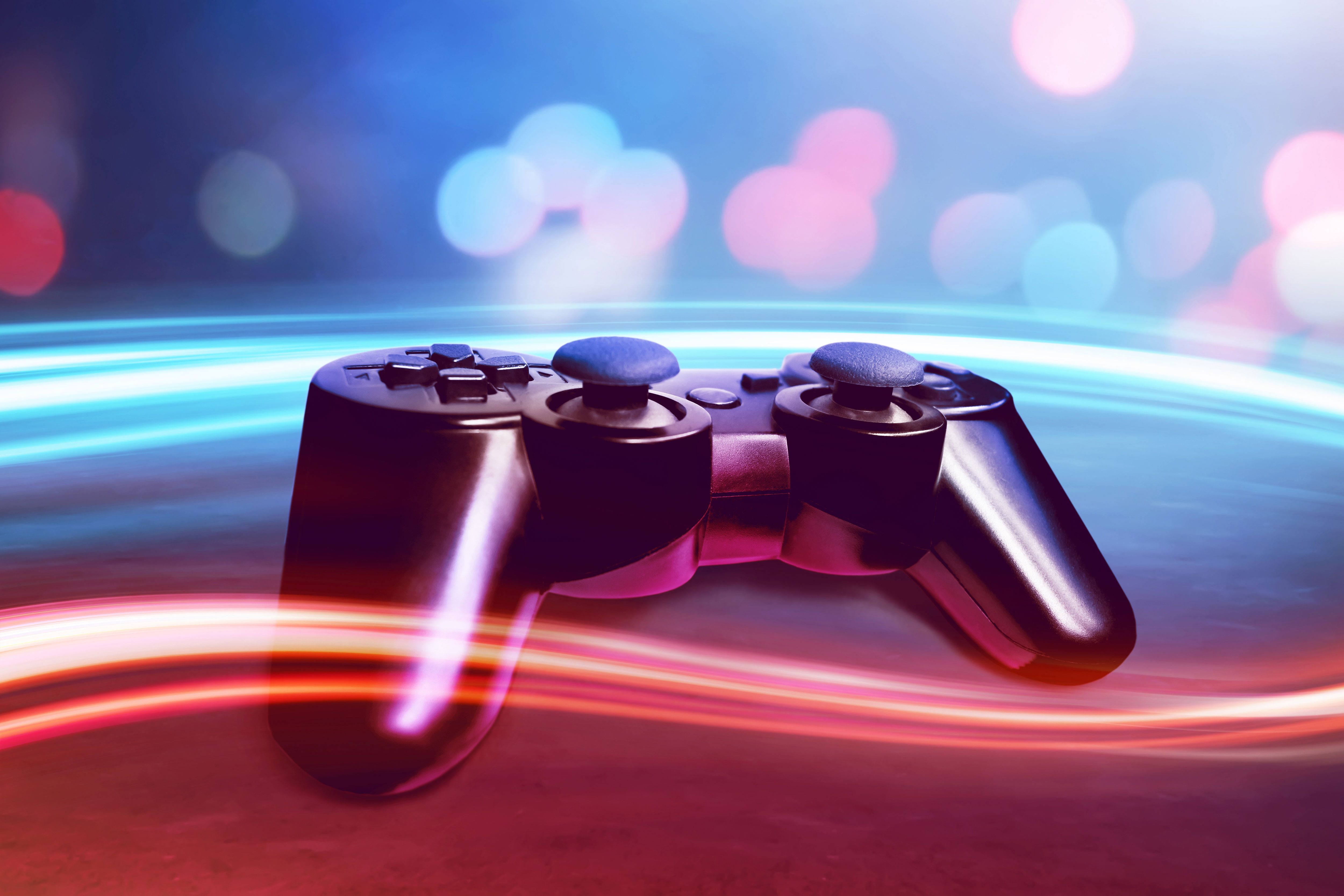 Video-game-controller-with-colorful-light-streaks