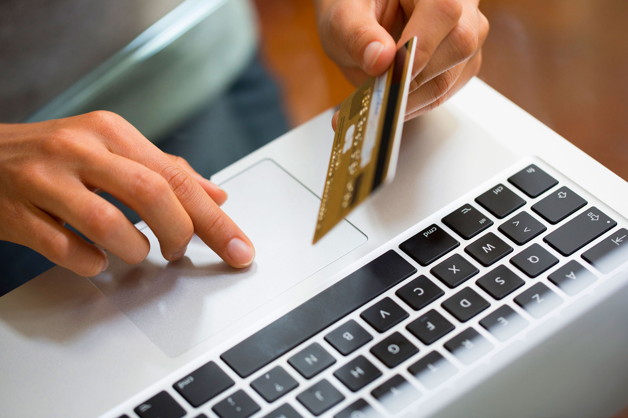Woman-using-laptop-and-credit-card-online-shopping