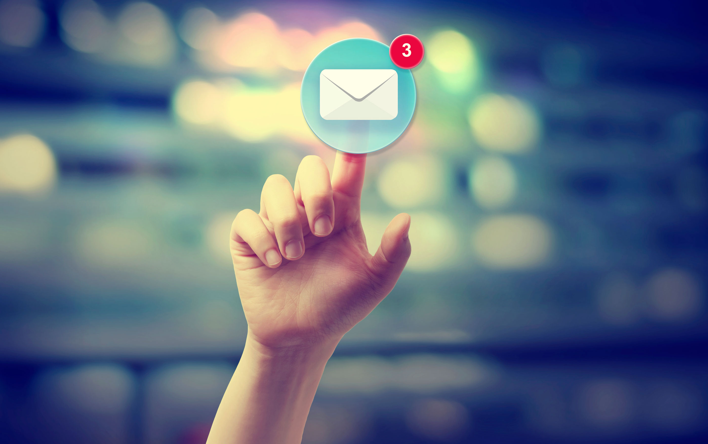 Hand-pressing-an-email-icon