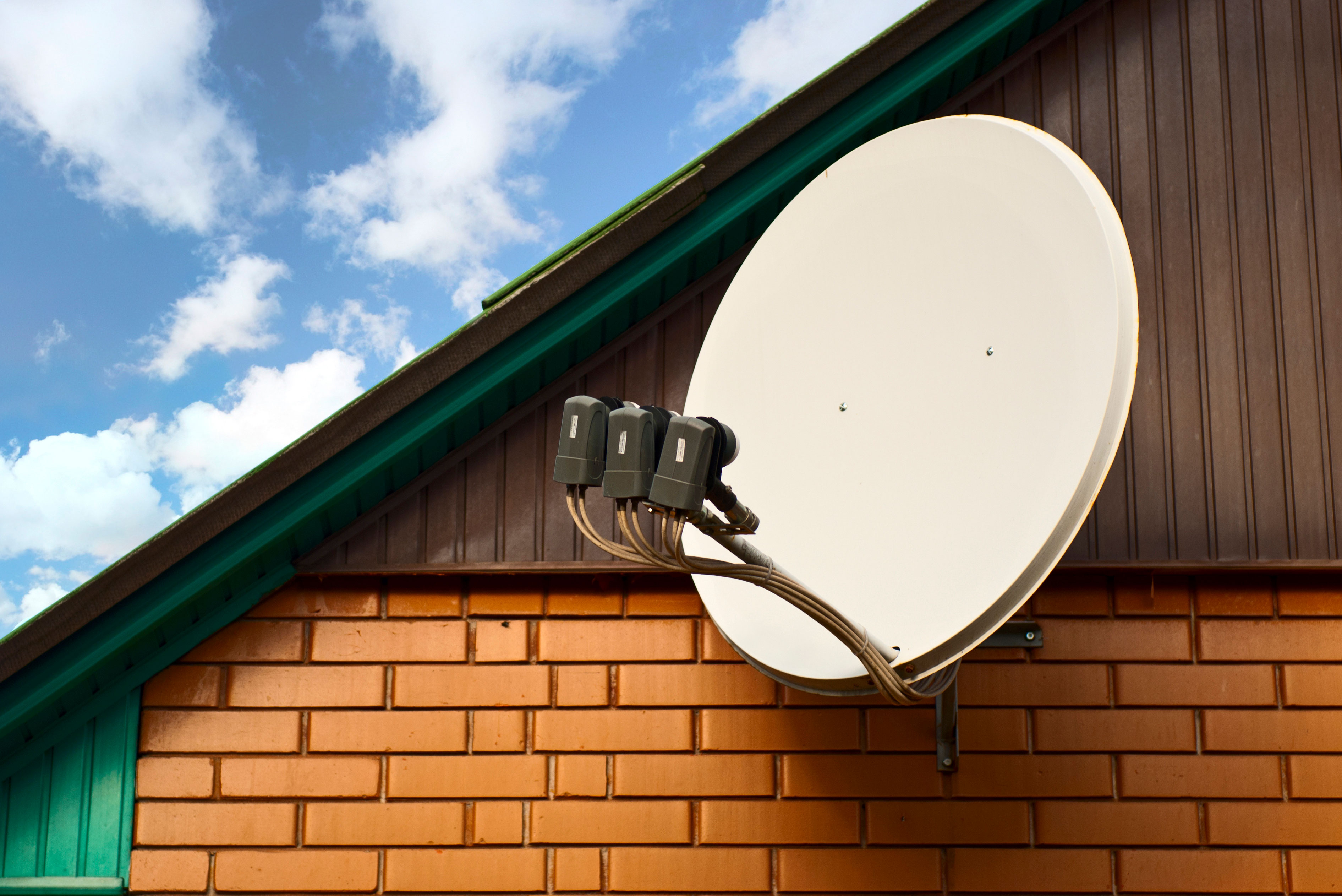 Satellite-dish-attached-to-house