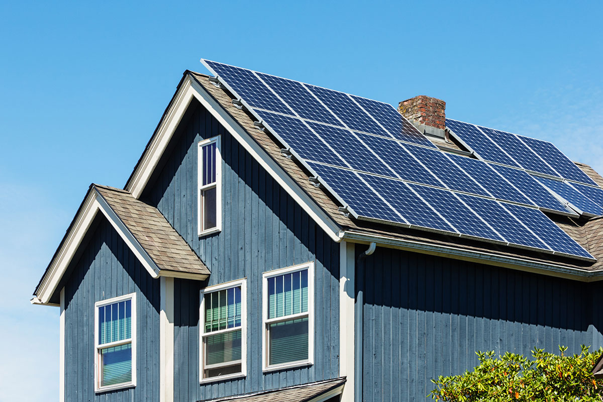 Traditional-American-Home-with-Modern-Solar-Panels-on-Roof