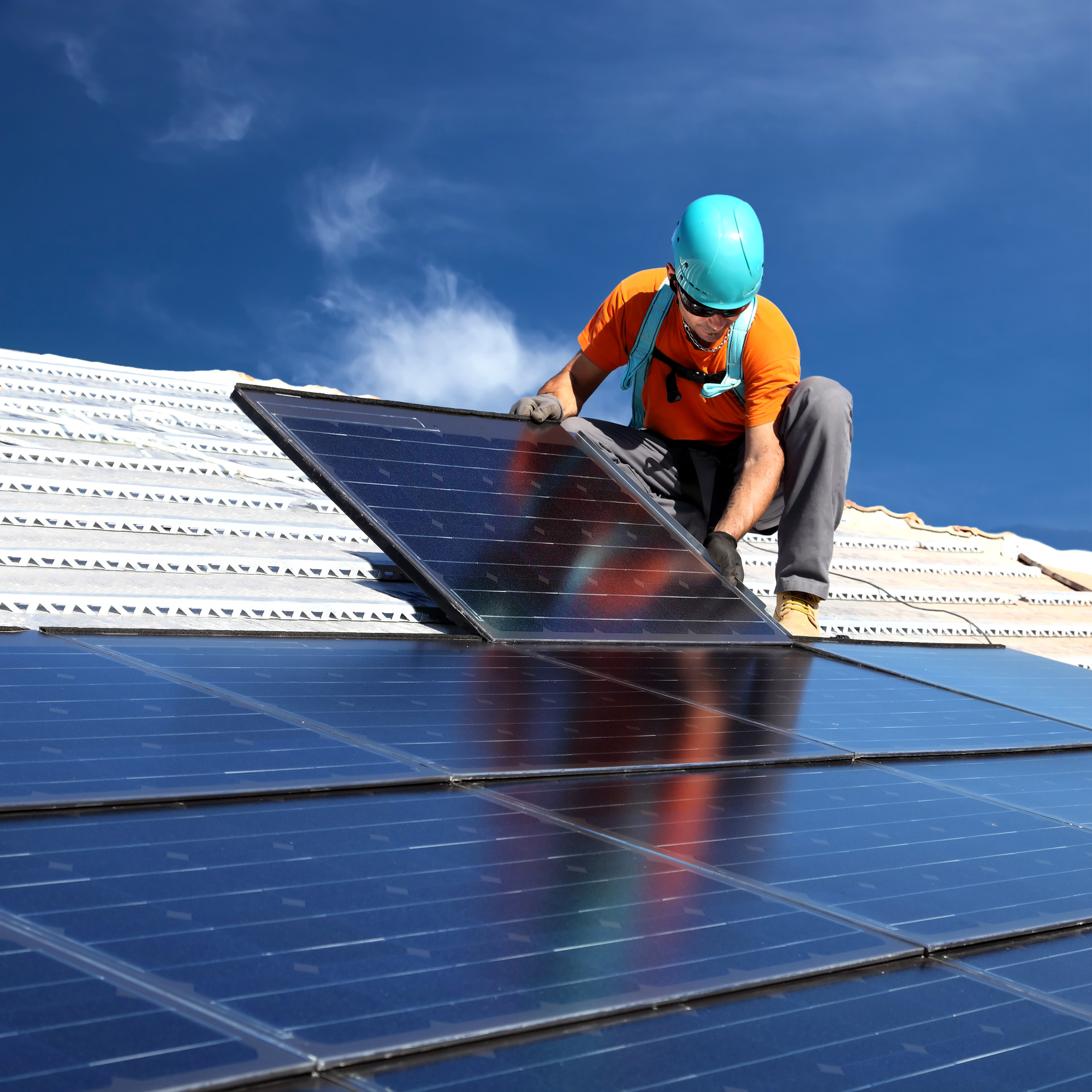 installing-alternative-energy-photovoltaic-solar-panels-on-roof