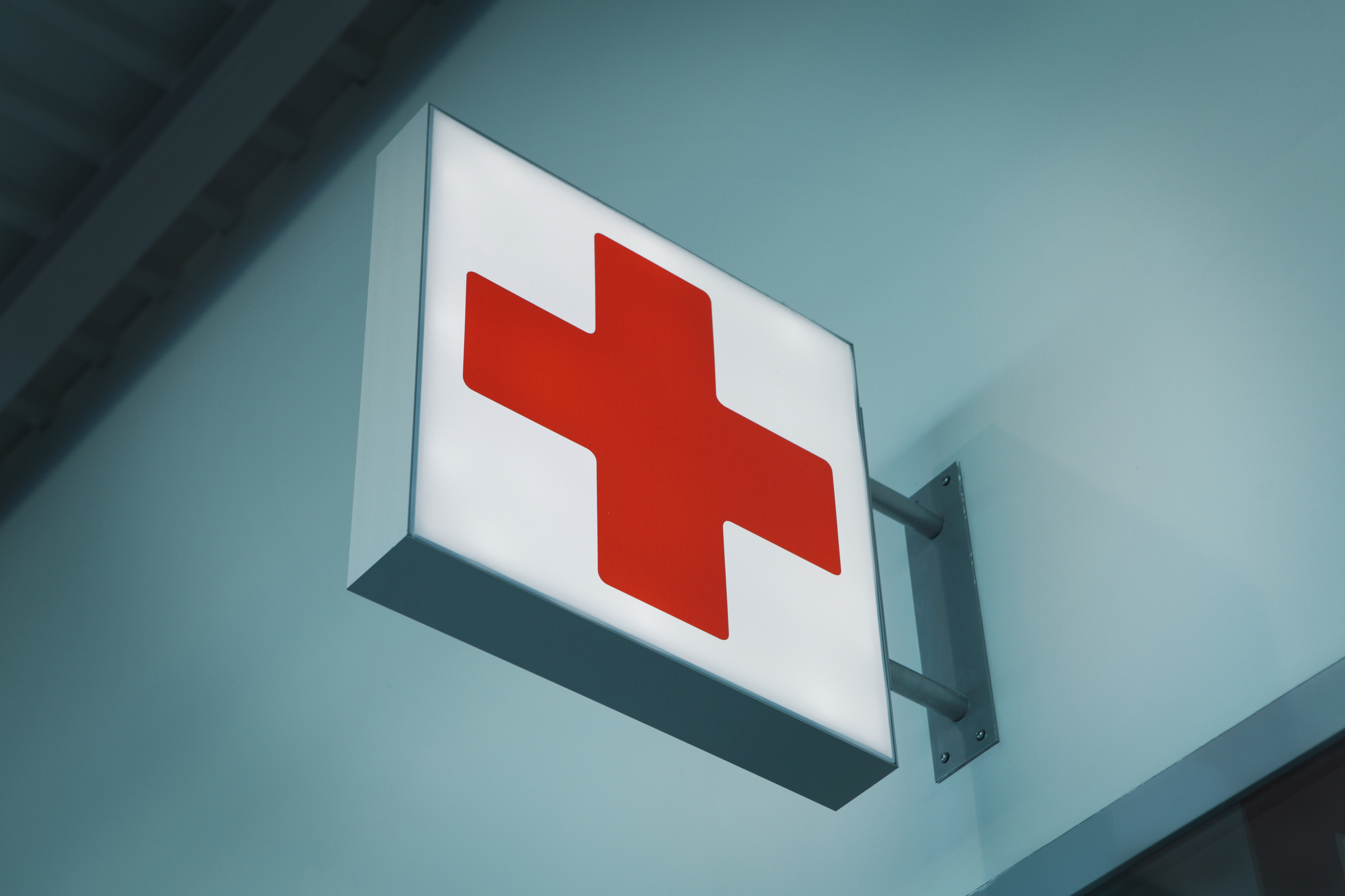 red_and_white_emergency_sign