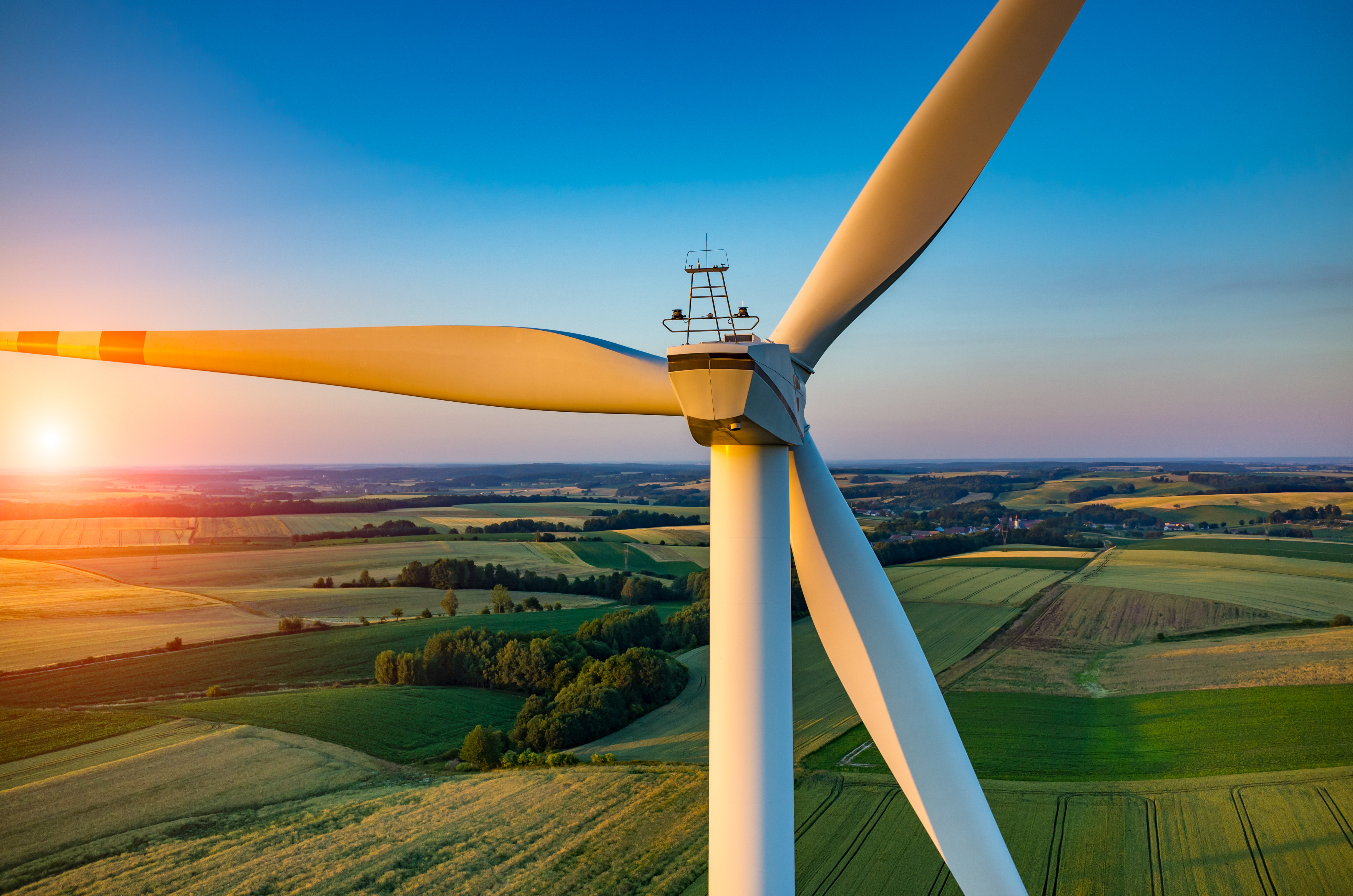 wind_turbine_with_grassy_hills_in_background