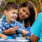 Nurse-examines-little-boy-at-outdoor-free-clinic_Thumbnail